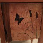 Marqueterie de roseaux et papillon
